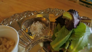 Slow motion fly over of a silver passover seder plate