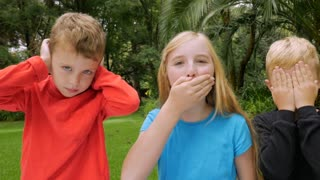 Three adorable young children play out see no evil, hear no evil, speak no evil in slow motion