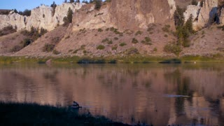 Tilt up of the white cliffs along the Lewis and Clark historic trail on the calm Missouri river in Montana.