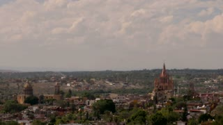 Time lapse of clouds moving against each other in San Miguel de Allende, Mexico overlooking the famous Parroquia church