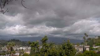 Timelapse of east Los Angeles, California facing the San Gabriel Mountains with heavy cloud movement