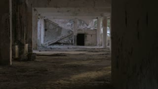 A creepy abandoned building with a crumbling staircase from a major earthquake and unknown shadows