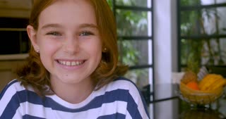 Adorable 10 year old girl smiling and looking at the camera - copy space