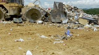ALEXANDER, NC, UNITED STATES - CIRCA MAY 2017 - Caterpillar bulldozer landfill compactor moving trash at a landfill