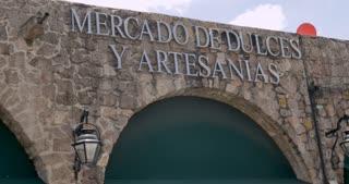 Artisan and sweet market, Mercado de Dulces y Artesanias sign in Morelia, Michoacan, Mexico - Establishing shot