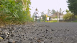 Background plate - runner running on a road towards the camera