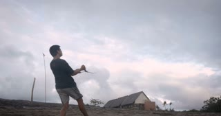 BALI, INDONESIA - CIRCA JAN 2018 - Man performing stunts and tricks with a two handle stunt kite