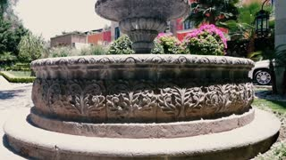Beautiful fountain in a park in San Miguel de Allende, Mexico near the Rosewood Hotel - crane up slow motion