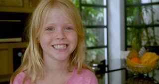 Blond haired young 7-10 year old girl with freckles smiling and looking at camera - copy space