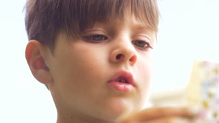 Close up of a preschool aged boy thinking and concentrating while learning in slow motion