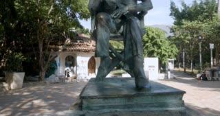 Crane up of the John Huston statue in the Rio Cuale park in Puerto Vallarta, Mexico