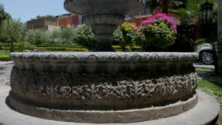 Establishing shot of a beautiful fountain in San Miguel de Allende, Mexico near the Rosewood Hotel - crane up slow motion