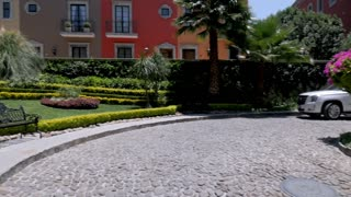 Establishing shot of new colorful houses in San Miguel de Allende, Mexico near the Rosewood Hotel - slow pan