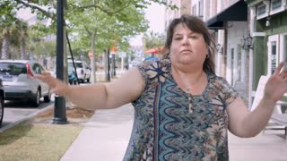 Full figured curvy attractive happy excited woman dancing in urban city