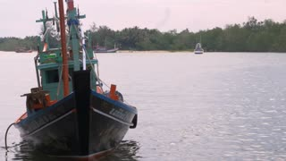 LANGSUAN, CHUMPHON, THAILAND - CIRCA FEB 2017 - Traditional wooden Thai squid fishing boat coming ashore