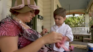 Mom wearing a spring easter outfit talking with her cute 4 - 5 year old son in slow motion