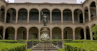MORELIA, MEXICO - CIRCA AUGUST 2018 - Inside the courtyard of Michoacan University of Saint Nicholas of Hidalgo (UMSNH) with a statue honoring Miguel Hidalgo