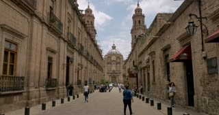 MORELIA, MEXICO - CIRCA AUGUST 2018 - View of the historic center down the pedestrian street Benito Juarez in Morelia looking at the Cathedral - gimbal stabilized shot