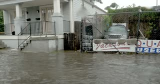 NEW ORLEANS, USA - JULY 22, 2017 - Fast moving water overwhelming the pumping system in Treme flooding parked cars and homes