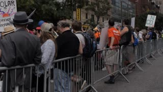 NEW YORK CITY, UNITED STATES - SEPTEMBER 21, 2014 - A metal barrier protects protestors at a climate change march at the People's Climate March