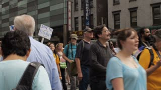 NEW YORK CITY, UNITED STATES - SEPTEMBER 21, 2014 - Father and son carrying a Humanistic Jews sign at the People's Climate March, a large-scale activist event to advocate global action against climate change.