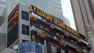 NEW YORK CITY, UNITED STATES - SEPTEMBER 21, 2014 - NASDAQ and financial stock news ticker at the Morgan Stanley office headquarters at 1585 Broadway