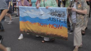 NEW YORK CITY, UNITED STATES - SEPTEMBER 21, 2014 - Old and young people marching and protesting to solve climate change at the People's Climate March