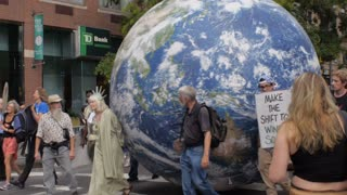 NEW YORK CITY, UNITED STATES - SEPTEMBER 21, 2014 - People carrying a large earth down the streets at the People's Climate March, a large-scale activist event to advocate global action against climate change.