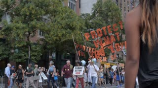 NEW YORK CITY, UNITED STATES - SEPTEMBER 21, 2014 - People protesting and marching at a climate change event on West 42nd Street at the People's Climate March, a large-scale activist event to advocate global action against climate change.