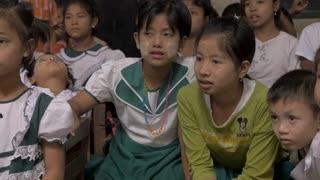 PAK NAM, CHUMPHON, THAILAND - CIRCA FEB 2017 - Happy smiling Burmese immigrant children sitting together in a Thai school
