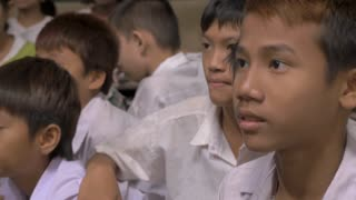 PAK NAM, CHUMPHON, THAILAND - CIRCA FEB 2017 - Mix of young Burmese girls with thanaka on their faces and boys divided by sex at a school