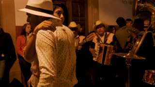 PATZCUARO, MEXICO - SEPTEMBER 15 2016 - Attractive young Mexican couple dancing together to a live band playing on the streets celebrating Mexican Independence Day