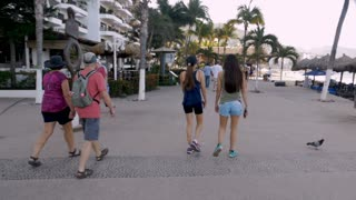PUERTO VALLARTA, MEXICO - CIRCA MARCH 2018 - Mexican and American tourists walking on the Malecon in slow motion