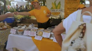 PUERTO VALLARTA, MEXICO - CIRCA MARCH 2018 - Mexican vendor giving out samples of gluten free food made of corn at the Saturday Market in slow motion