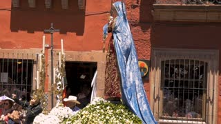 SAN MIGUEL DE ALLENDE, MEXICO - CIRCA MARCH 2016 - Virgin Mary statue on a parade float during Semana Santa Easter Holy week celebration