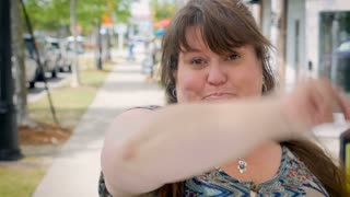 Sassy full figured woman on the city sidewalk saying expressing doubt and a negative emotion