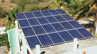 Solar panels on the roof of a residential home or garage collecting clean, renewable energy from the sun