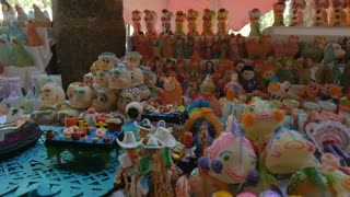 Sugar skulls, animals, skeletons, angels, and miniature scenes for sale for Day of the Dead in Patzcuaro Mexico