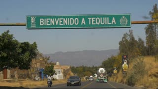 TEQUILA, MEXICO - CIRCA FEB 2017 - Driving into the town of Tequila past the Bienvenido a Tequila welcome sign with bullet holes