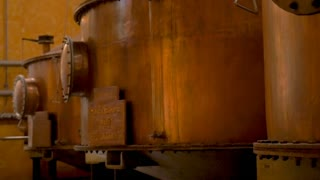TEQUILA, MEXICO - CIRCA FEB 2017 - Large copper distillery tanks used for making tequila at the Jose Cuervo factory plant