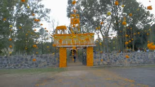 TZURUMUTARO, MEXICO - NOVEMBER 1, 2016 - POV walking into the entrance of a cemetery decorated with Marigold flowers for the Mexican celebration Day of the Dead