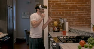 Young man wearing VR headset dancing having fun with a virtual reality experience like he is attending a music festival or concert