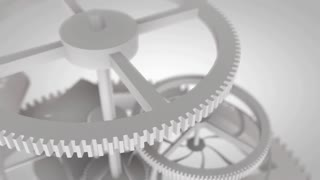 White gears in motion in a mechanical device. Gearbox rotating machine parts