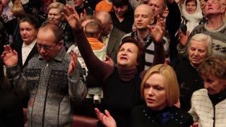 People in a prayer meeting