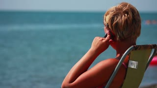 Woman Talking on the Phone at the Beach 2