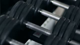 Athlete Takes A Dumbbell For Training. Slow-Mo
