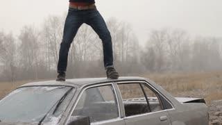 Attack on car. Hooligan baseball bat destroy car window. Slow-mo
