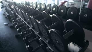 Black Dumbbells In The Gym