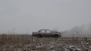 Car explosion on an empty field. Side view