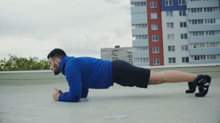 Cinematic Plank Workout For Male Athlete On The Roof